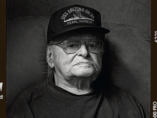 Raymond Haerry was thrown off the deck of the USS Arizona when the armored piercing bomb exploded near the ship's powder magazine. He swam to shore through the burning waters to Ford Island where he manned a machine gun for the remainder of the attack. He stayed in the Navy for another two decades and was teaching officer candidates in Rhode Island when he retired.