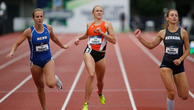 UC Santa Barbara's Tori Usgaard, left, Oregon State's Kara Hallock, center, and Nevada's Nicole Wadden, right, cross the finish line in a heat of the heptathlon 200 meters on the third day of the NCAA outdoor college track and field championships in Eugene, Ore., Friday, June 9, 2017.