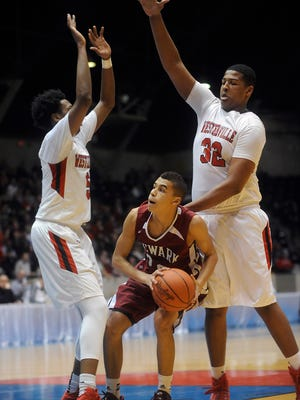Newark junior Kaysey Brokaw-Henderson is trapped between Westerville South defenders Andre Wesson and Kaleb Wesson. The Wildcats fell to Westerville South in a Division I regional semifinal on Wednesday at the Ohio State Fairgrounds Coliseum.
