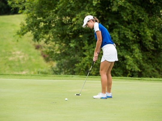 Tori Ross sinks a putt on the 16th hole to become the 2018 Women's York County Amateur Golf Association champion at Honey Run Golf Club in Dover Township on June 20, 2018.