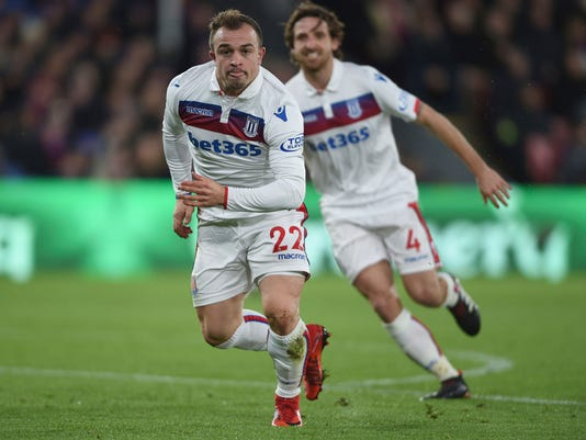 Stoke City's Xherdan Shaqiri celebrates scoring his side's first goal of the game against Crystal Palace, during their English Premier League soccer match at Selhurst Park in London, Saturday Nov. 25, 2017. (Daniel Hambury/PA via AP)