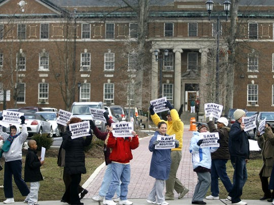Protesters in 2008 demonstrated against the closure of Muhlenberg in Plainfield.