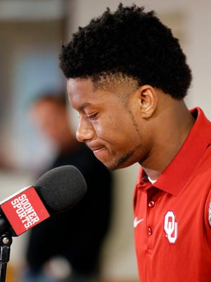 Oklahoma football player Joe Mixon speaks out for the first time since the release of a 2014 video showing him striking Amelia Molitor, at a press conference in Norman, Okla., Dec. 2016.