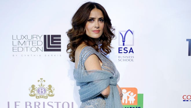 """Mexican actress Salma Hayek poses for photographers as she arrives for a charity dinner following her international premiere film """"The Prophet"""", an animated feature film she co-produced, in Beirut, Lebanon on April 27, 2015."""