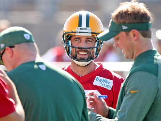 Green Bay Packers quarterback Aaron Rodgers (12) smiles