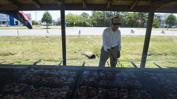 Veteran Jack Lynch tends to the chickens at the VFW Chicken Shack in Bethany Beach in 2014. After bad storms, the shack was blown down, but is now being rebuilt for free.