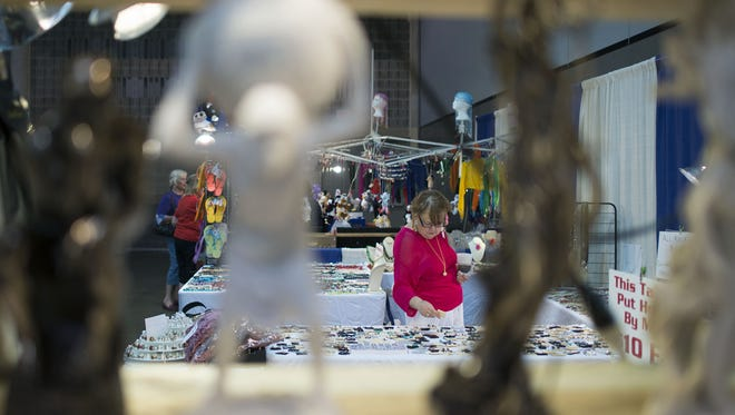 FILE: People shop around merchants set up in the Roland E. Powell convention center as the Greek Festival. The 2016 festival begins July 29.