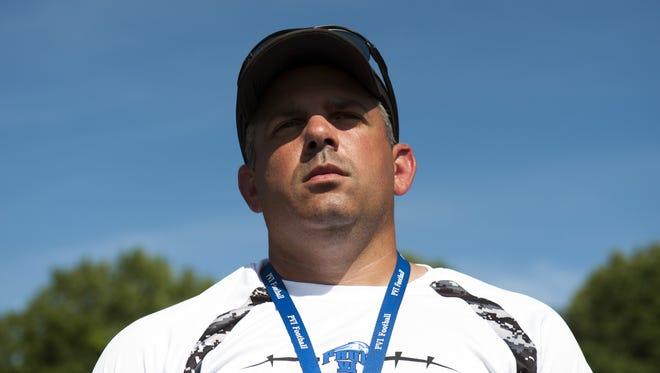 Phil Brunozzi resigned as head coach of the Paul VI football team Wednesday.