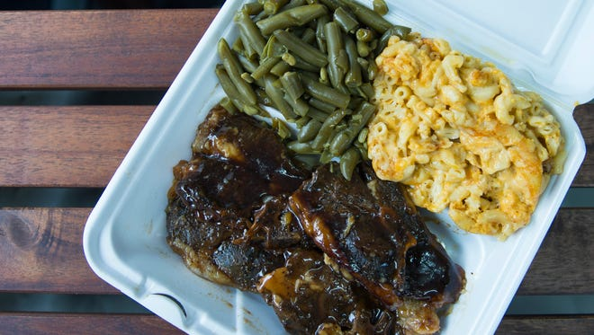 Lamb chops with sides of green beans and mac 'n' cheese from Food for your Soul in Philadelphia.