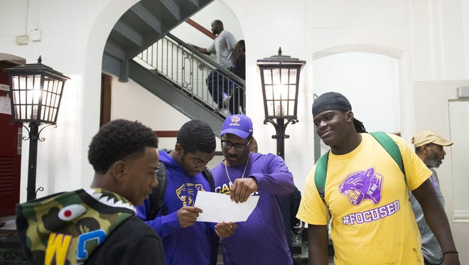 Camden High counselor and track coach Kenneth Miller, center, speaks with students inside Hatch Middle School Tuesday, Aug. 29, 2017 in Camden. Students are relocating to Hatch Middle School for the upcoming school year.