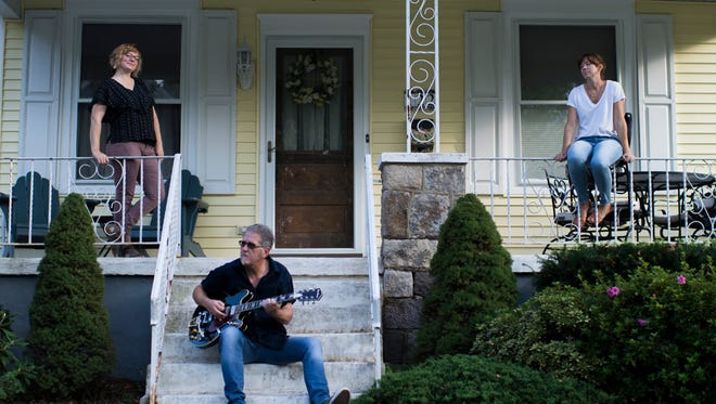 Stacey Brown Downham (from left), Kevin Monko and Sara Neal gather on a Collingswood porch to promote Porchfest. The townwide music and arts festival takes place Saturday from noon to 5 p.m.