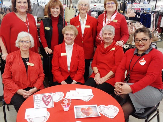 Valentine Ladies Jan Ranard, Linda Cox, Janis Fogle, Pat Furterer, Carol Williams, Sue Lundy and Kay Bolin helped spread a message of love with Stein Mart manager Sonia Bauer during a visit there in February.