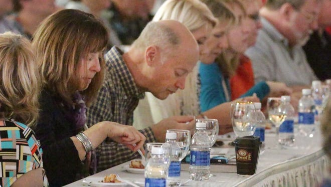 People taste food samples while listening to the cooking wisdom of Jacque and Claudine Pepin during the 15th annual Kohler Food & Wine Experience Saturday 24, 2015, 2015 in Kohler.