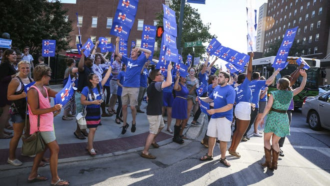 Supporter of Democratic presidential candidate Hillary Clinton cheer outside the Cedar Rapids Convention Center before the Iowa Democratic Party's Hall of Fame Celebration in Cedar Rapids Friday July 17, 2015.