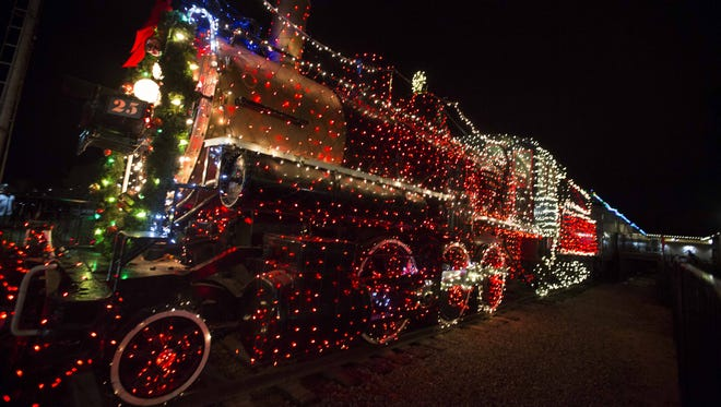 The Holiday Express Locomotive is covered in Christmas lights and welcomes visitors at the McCormick-Stillman Railroad Park, Saturday, Dec. 12, 2014, in Scottsdale.