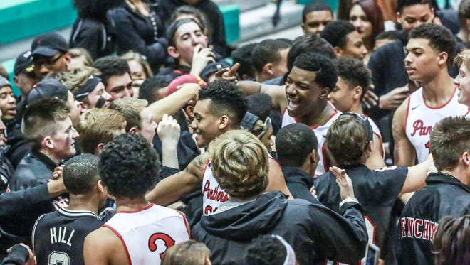 North Central fans congratulate the team after winning the 2016 IHSAA boys basketball sectional at Tech Saturday night.