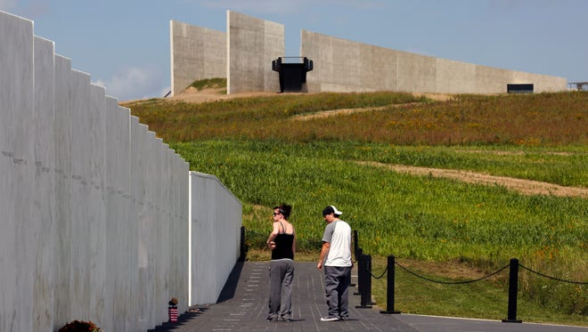 Visitors walk along the Wall of Names at the Flight 93 National Memorial in Shanksville, Pa, on Wednesday, Sept. 9, 2015.