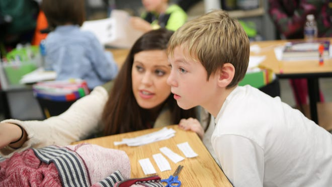 Brooke Janes works on a lesson with Jaxon Hayes at Gene Brown Elementary in Hendersonville.