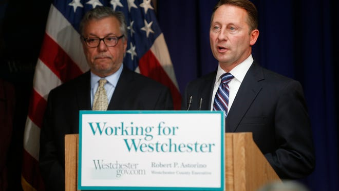 Westchester County Executive Robert Astorino with Neal DeLuca, who is representing the developer, Fareri Associates.