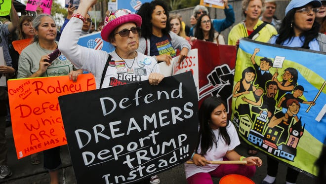 Immigration activists protest the Trump administration's decision to end the Deferred Action for Childhood Arrivals (DACA) program on Wednesday in Newark, N.J.