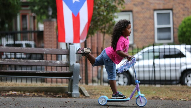 Angelina Santos, 4, of Yonkers rides her scooter while her family volunteers at a donation drive for hurricane victims in Puerto Rico Oct. 8, 2017 at O'Boyle Park in Yonkers. Santos' father, Luis Santos, came to New York from Puerto Rico ten years ago, where his family still lives and are dealing with the aftermath of the hurricanes.