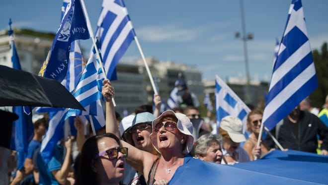 Protesters demonstrate against the agreement between Greece and Macedonia over dispute of the former Yugoslav's republic name, outside the Greek Parliament, in Athens, on June 15, 2017.