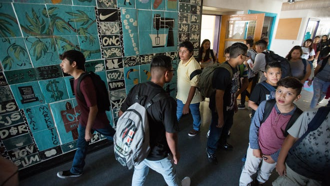 Students at La Academia Dolores Huerta walk to classes on Thursday, August 16, 2018.