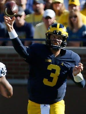 Michigan quarterback Wilton Speight throws downfield during first half action September 24, 2016.