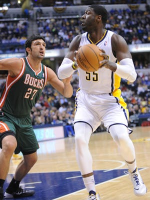 Roy Hibbert eyes the basket as he is defended by Zaza Pachulia of the Bucks. The Indiana Pacers hosted the Milwaukee Bucks in NBA action at Bankers Life Fieldhouse Thursday February 27, 2014.