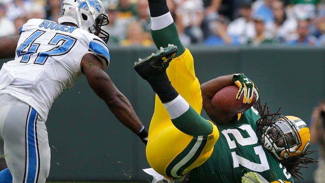 Green Bay Packers running back Eddie Lacy (27) picks up 7 yards on a play in the third quarter after being stopped by Detroit Lions free safety Glover Quin (27) during the Green Bay Packers 34-27 win over the Detroit Lions  during the NFL football game at Lambeau Field in Green Bay, WI, Sunday, September 25, 2016.