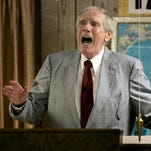 The Rev. Fred Phelps Sr. preaches at his Westboro Baptist Church in Topeka, Kan., in this file photo. Phelps, the founder of the Kansas church known for anti-gay protests and pickets at military funerals, died.