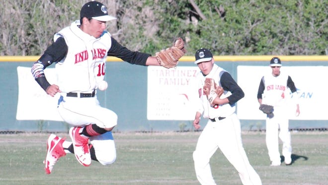 Cobre's Andru Sanchez saves this pick off play from going into centerfield after Silver's Peter Alarid slides back into second base.