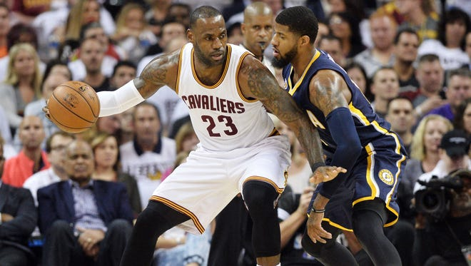Cleveland Cavaliers forward LeBron James (23) works against Indiana Pacers forward Paul George (13) during the first half in game two of the first round of the 2017 NBA Playoffs at Quicken Loans Arena.