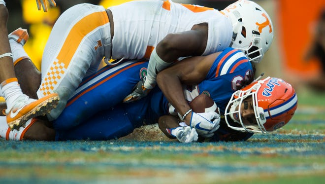 Florida wide receiver Tyrie Cleveland (89) catches a 63-yard desperation pass as Tennessee defensive back Micah Abernathy (22) fails to block him during the Tennessee Volunteers vs. Florida Gators game at Ben Hill Griffin Stadium in Gainesville, Florida Saturday, Sept. 16, 2017. Florida defeated Tennessee 26-20.