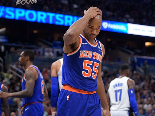 New York Knicks guard Jarrett Jack (55) reacts after a basket by Orlando Magic forward Jonathon Simmons (17) during the second half of an NBA basketball game Wednesday, Nov. 8, 2017, in Orlando, Fla. The Magic won 112-99. (AP Photo/Phelan M. Ebenhack)