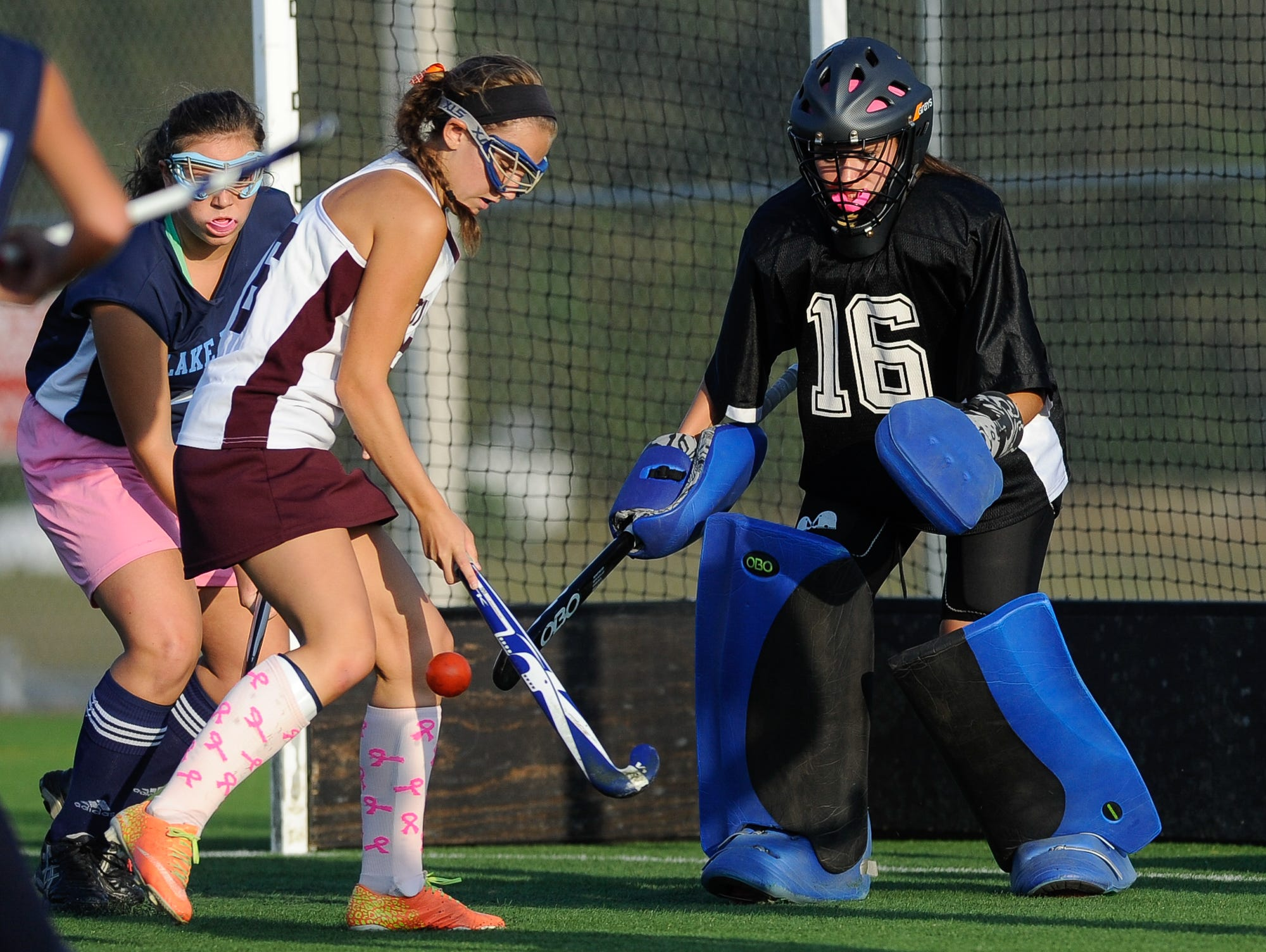 Lake Forest field hockey goalie Allison Bishop (No. 16) defends in their game against Milford.