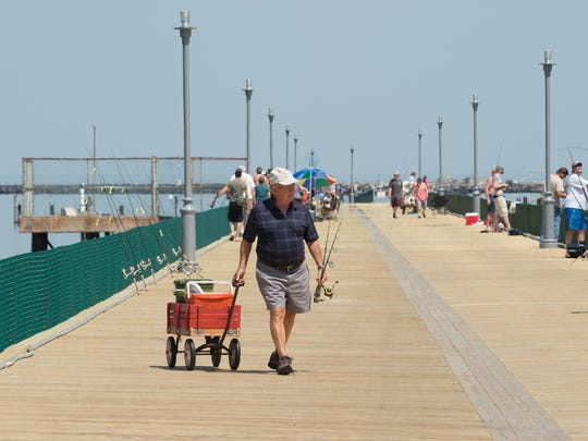 Dr. Art Henry of Lewes pulls his fishing gear down the newly reopened fishing pier at Cape Henlopen State Park in Lewes.