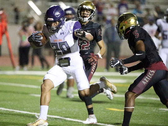 Eastlake running back Ivan Avina, 20, runs into the end zone for a touchdown against El Dorado Thursday night at the Socorro Activities Complex.