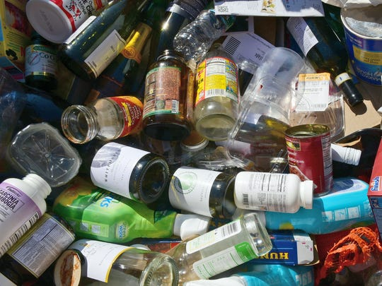 Bottles, glass and plastic are in a single-stream bin Wednesday, September 27, 2017 at Washington Township Transfer Station.