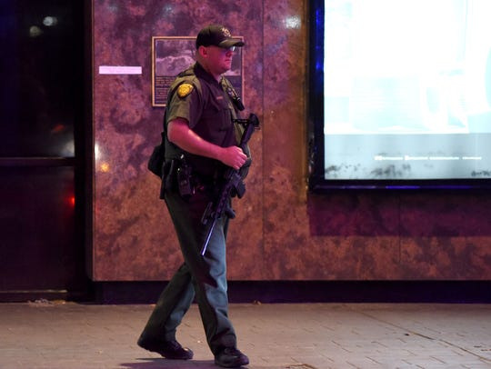 A sheriff's deputy walks along an empty Virginia Street during the shooting at The Montage in downtown Reno on Tuesday evening Nov. 28, 2017.