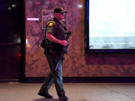 A sheriff deputy walks an empty Virginia Street during the shooting at the Montage Appartments in downtown Reno on Tuesday evening Nov. 28, 2017.