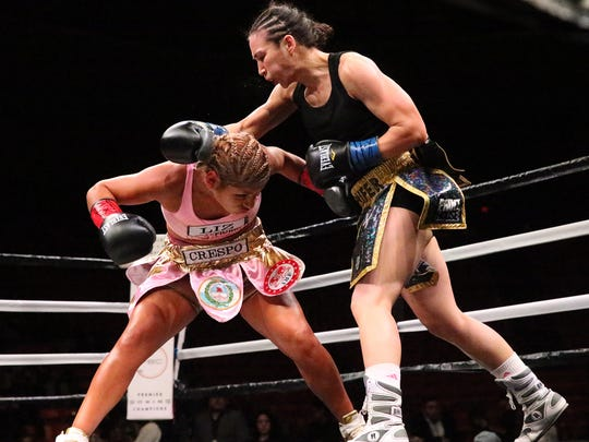 Lizbeth Crespo ducks to avoid a punch from El Paso boxer Jennifer Han at the Don Haskins Center in 2018.
