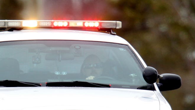 Flashing lights are shown on a police car on an emergency run on March 7, 2013.