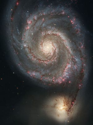 M51, the Whirlpool Galaxy in Canes Venatici, pictured by Hubble Space Telescope.
