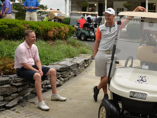 From left, Chris Gebhard and Noah Firestone chat prior to the start of the championship flight during the 71st edition of the W. B. Sullivan Invitational Fourball held at the Lebanon Country Club on Saturday.