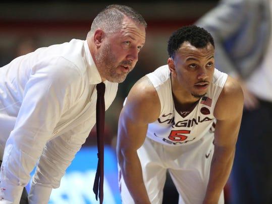 Virginia Tech coach Buzz Williams talks with Justin Robinson during the second half against Clemson in an NCAA college basketball game in Blacksburg Va., Wednesday, Feb. 21, 2018. (Matt Gentry/The Roanoke Times via AP)