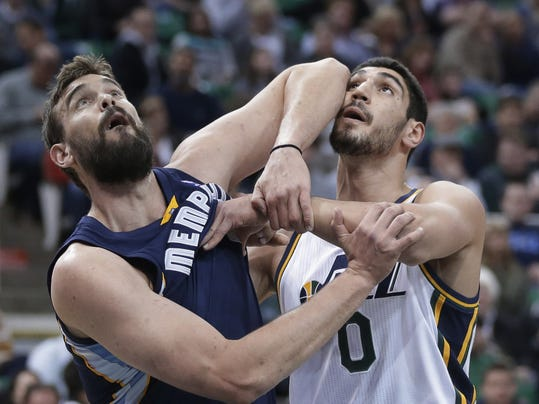 Memphis Grizzlies' Marc Gasol, left, of Spain, and Utah Jazz's Enes Kanter (0), of Turkey, wait for a rebound in the first quarter of an NBA basketball game Wednesday, March 26, 2014, in Salt Lake City. (AP Photo/Rick Bowmer)