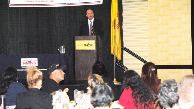 NMVAHCS Director Andrew Welch thanks the women in attendance for their military service on Saturday in Albuquerque.