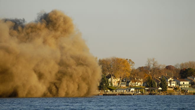 A cloud of dust crosses over the St. Clair River Saturday after the implosion of the former Marysville DTE plant. A cloud of dust crosses over the St. Clair River after the implosion of the former Marysville DTE plant.