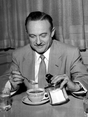 "The Commercial Appeal files Here for a speaking engagement to the Kiwanis Club on April 7, 1954, famous labor reporter Victor Riesel was ready for talk of unions and communists as he enjoyed a cup of coffee after his arrival from New York. His column, ""Inside Labor,"" is published regularly in The Commercial Appeal."